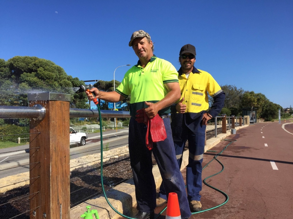 Eddie Brown (left) and Max Doyle with fencing cleaned along West Coast Drive.