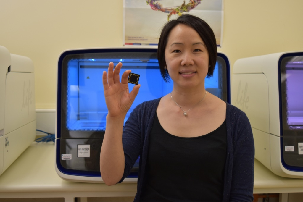 St Charles Gairdner Hospital medical oncologist Annette Lim with a sequencing chip used in cancer research.