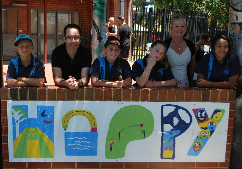 Wanneroo Mayor Tracey Roberts (second from right) with Neerabup Primary School students and one of the murals.