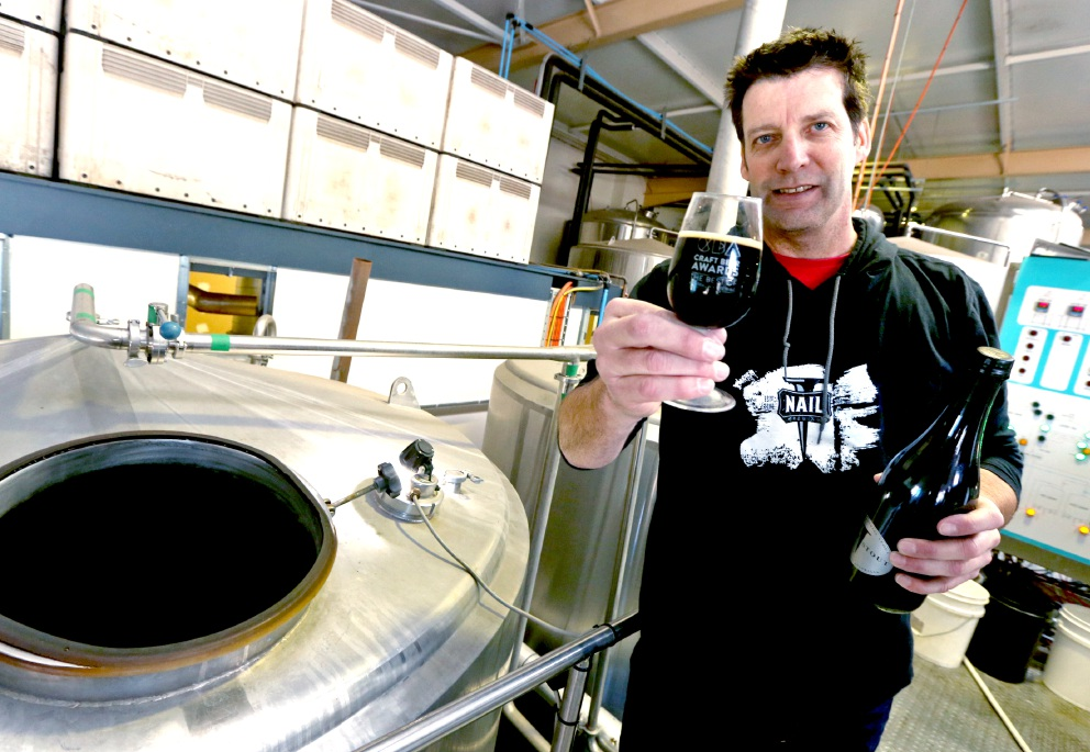 Plenty of clout: Nail Brewing owner John Stallwood with his award-winning beer. Picture: Matt Jelonek    d457010