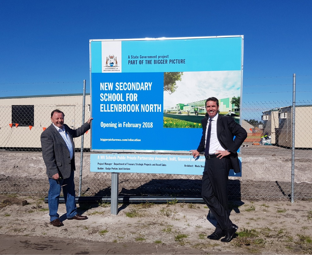 Frank Alban and Peter Collier at the site of the new school.