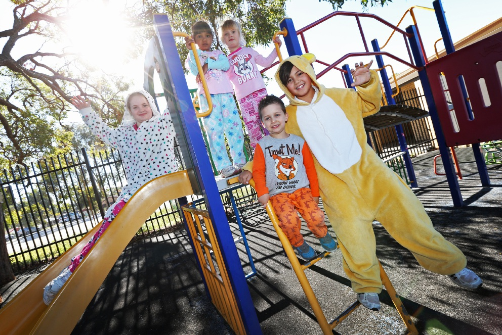 Year 5 student Kaitlyn Moro, Kindy student Asha Hodges, Tyrone Molostov with Ruby Watson and Year 6 student Trey Donovan in their PJs. Picture: Matt Jelonek d454731
