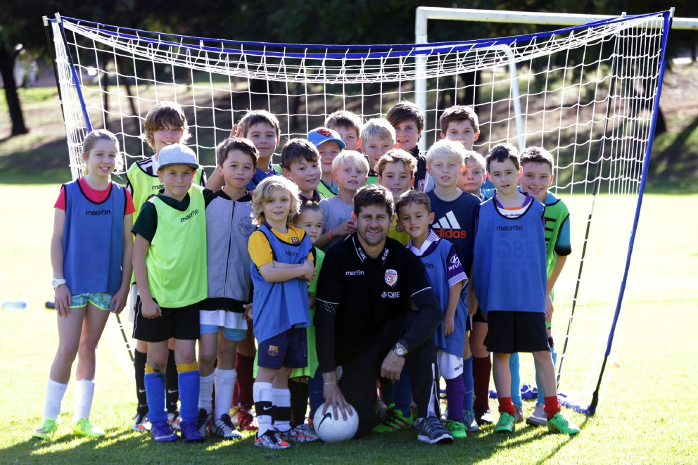 Michael Garcia with young soccer players.