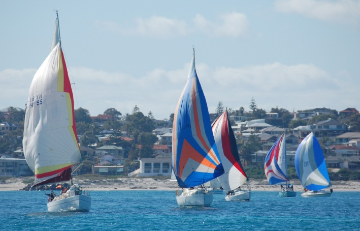 Hard Evidence, Sandrine, Show Me, Helga and Volant flying their spinnakers.