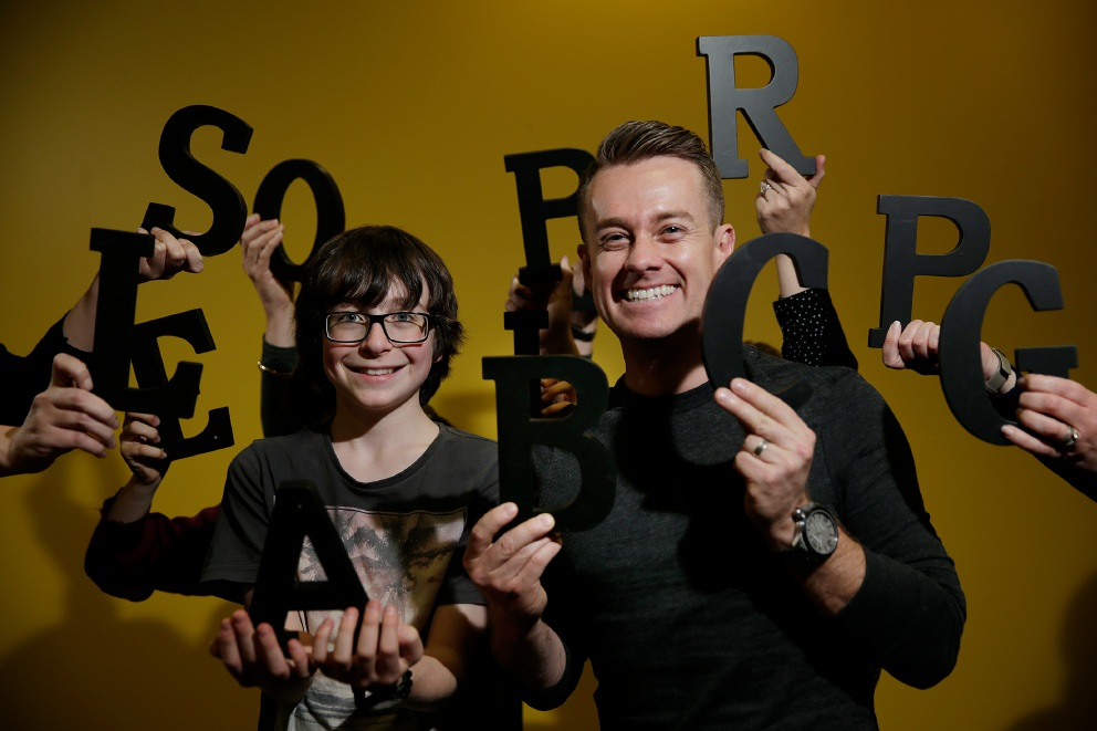 Beau Scaddan (12) and The Great Australian Spelling Bee co-host Grant Denyer.