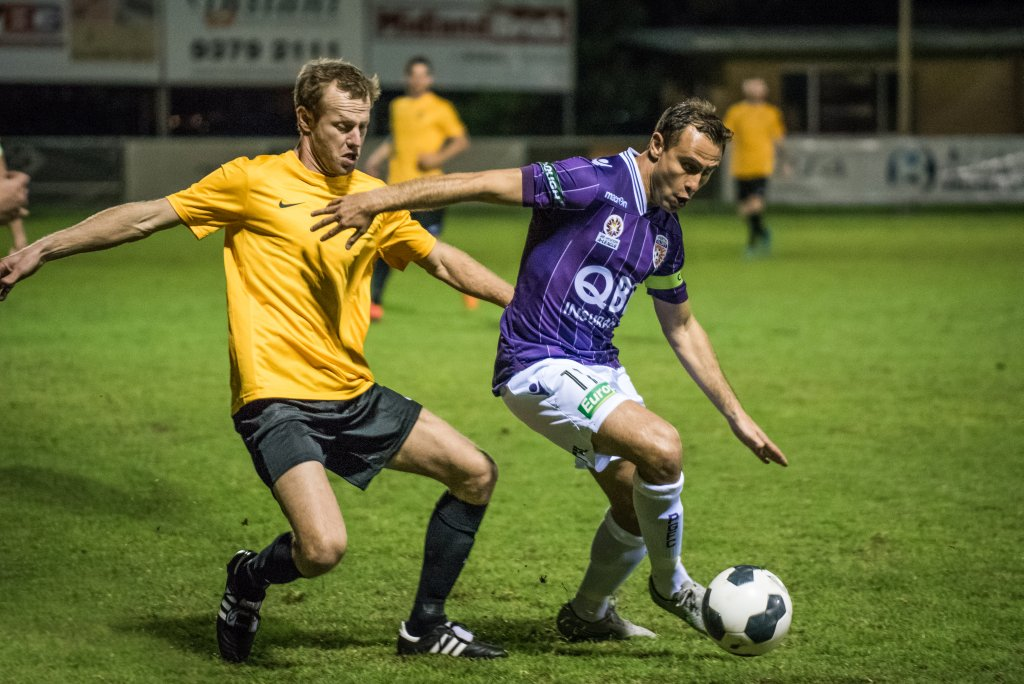 Trent Kay (WA) and Richie Garcia during last year's friendly between Perth Glory and WA. Picture: Vince Caratozzolo.