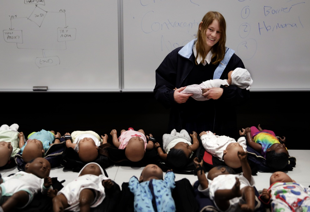 Carrying the baby: Year 11 student Amy Rowell cradles a 'virtual baby' during the parenting program.  Picture: Martin Kennealey www.communitypix.com.au   d457432
