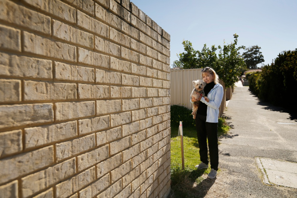 Betty Gibbings (with her dog Tommy) is relieved she will not have to knock down her front wall. Picture: Andrew Ritchie  www.communitypix.com.au   d457060