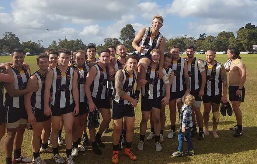 Beau Barratt is chaired off for his 150th game.