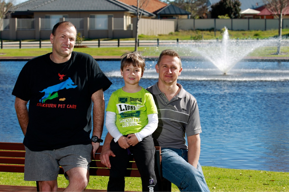 The Success Residents Association president Corey Gaidzionis with his son Riley (7) and Rob Finestone. Picture: Marie Nirme