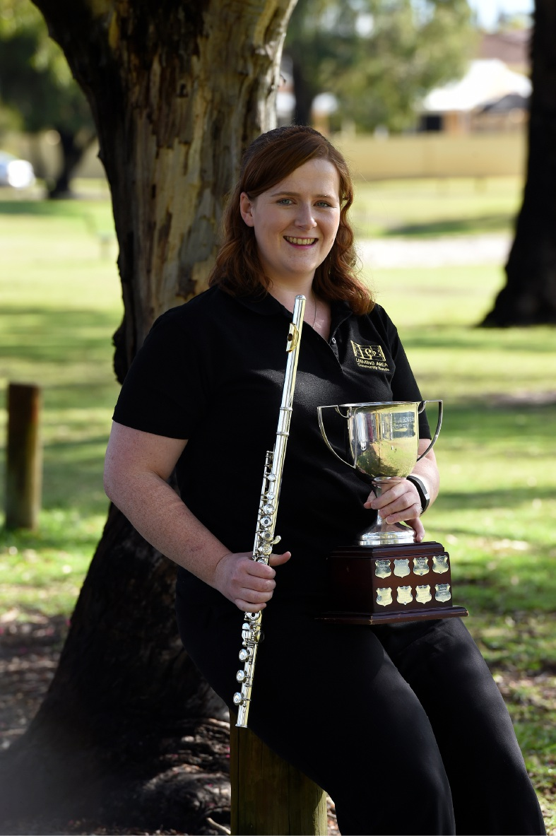 Leeming Area Concert Band principal flautist Elizabeth Searson with the Ray Lorner Trophy for Best Soloist in a Concert Band.