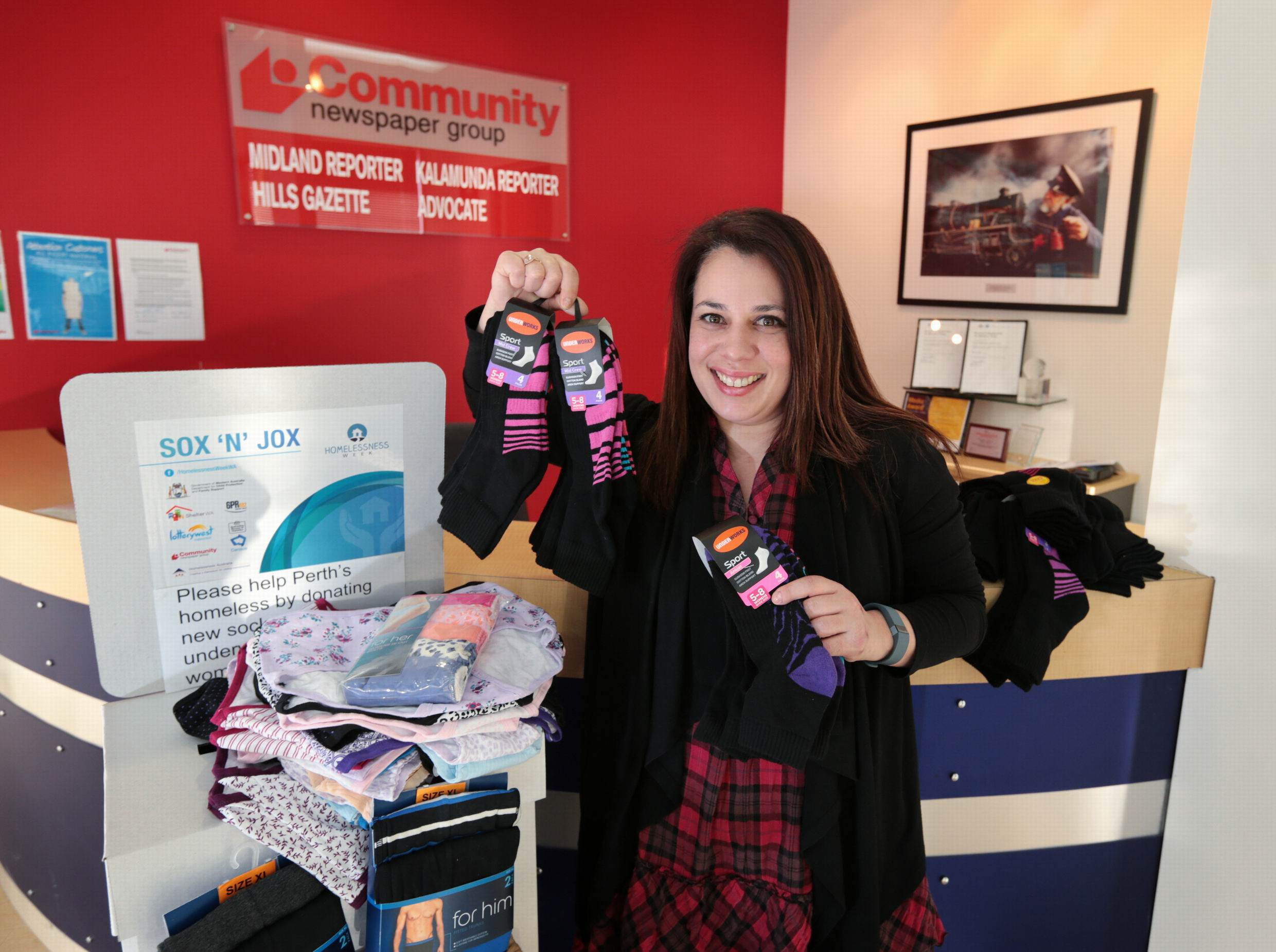 Midland office receptionist Vanessa Eastwell with the large Sox 'N' Jox donation at the Midland office.
