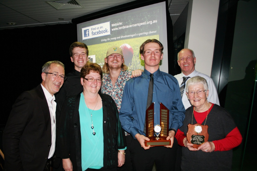 Damien Burrage with his family and dinner guest Ben Elton (left).