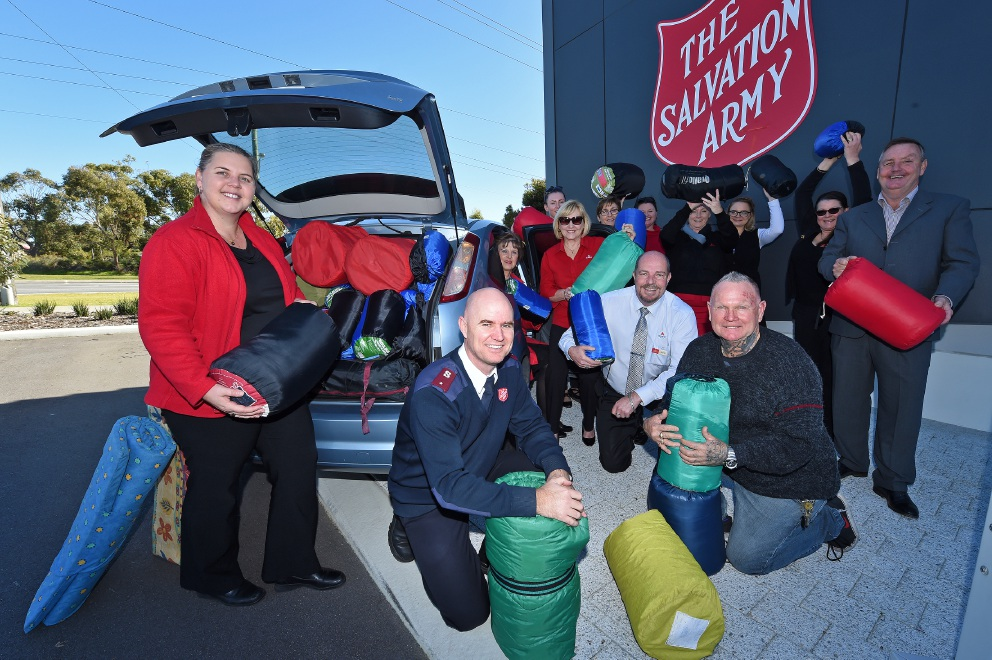 Summit Realty Waikiki staff donated sleeping bags to the Salvation Army appeal