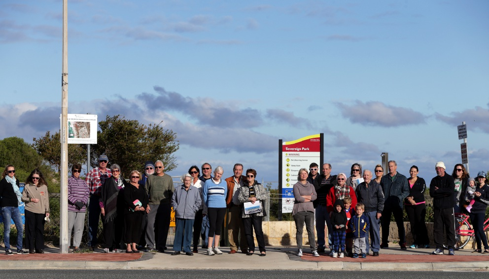 Concerned residents gather at the beach to object to the stairway demolition. Pictures: Martin Kennealey www.communitypix.com.au   d457798 The beach access stairs at Two Rocks.