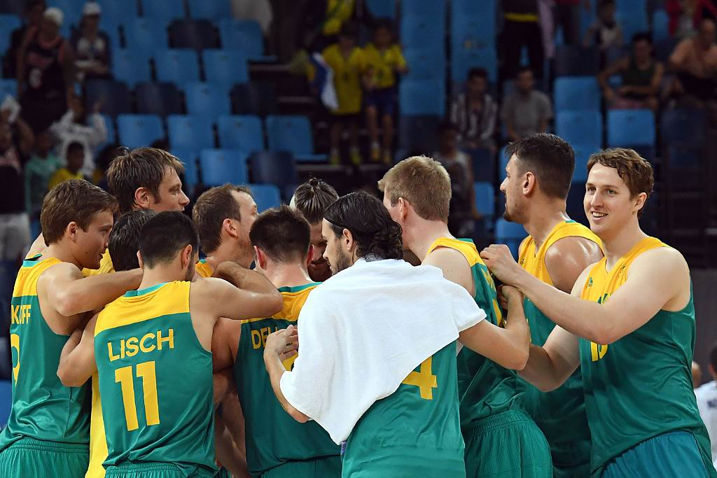 The Boomers celebrate their win over Serbia. Picture: Mark Ralston/Getty Images