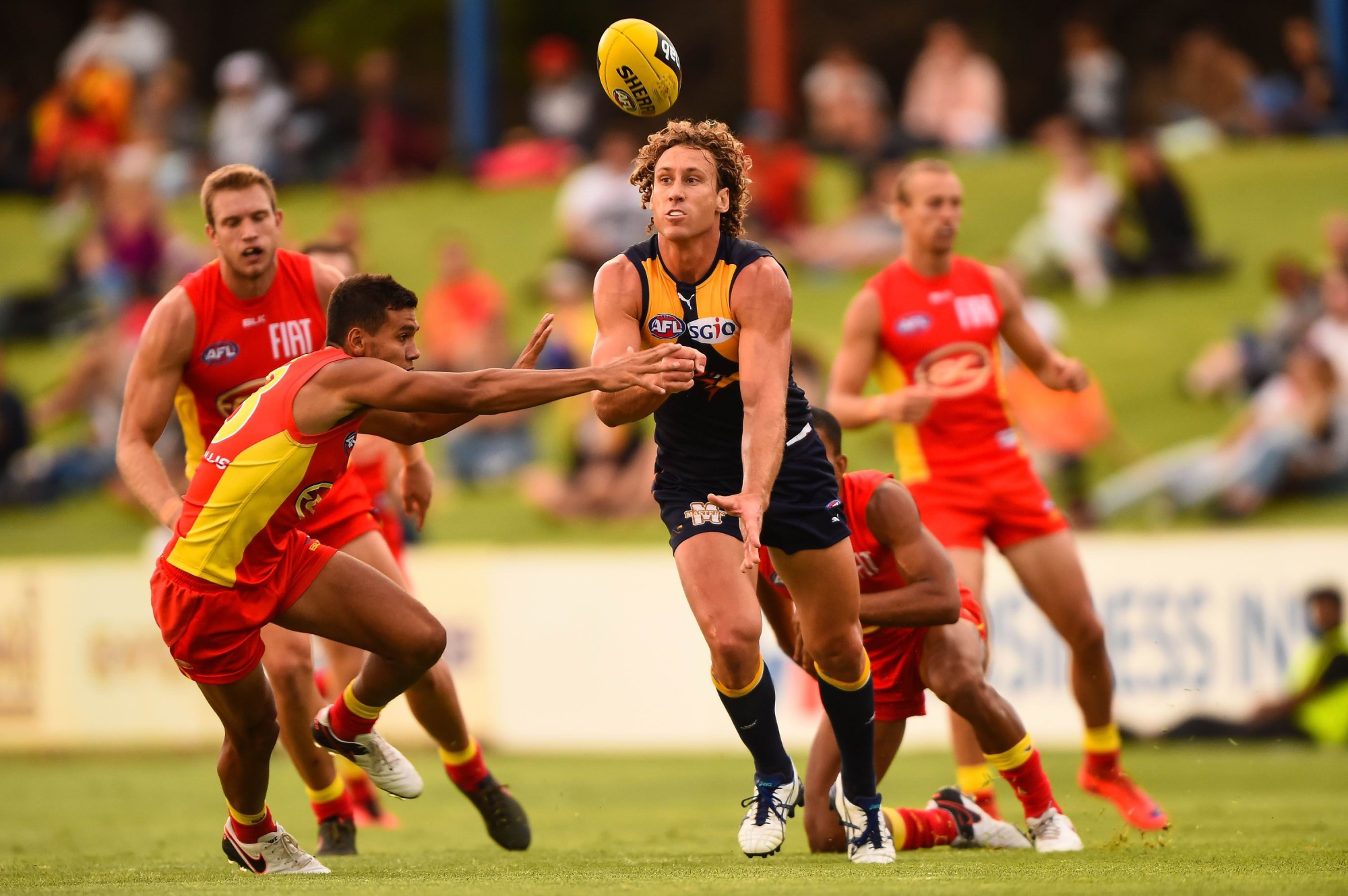 Matt Priddis gets a handpass away under pressure. Picture: Daniel Carson/AFL Media