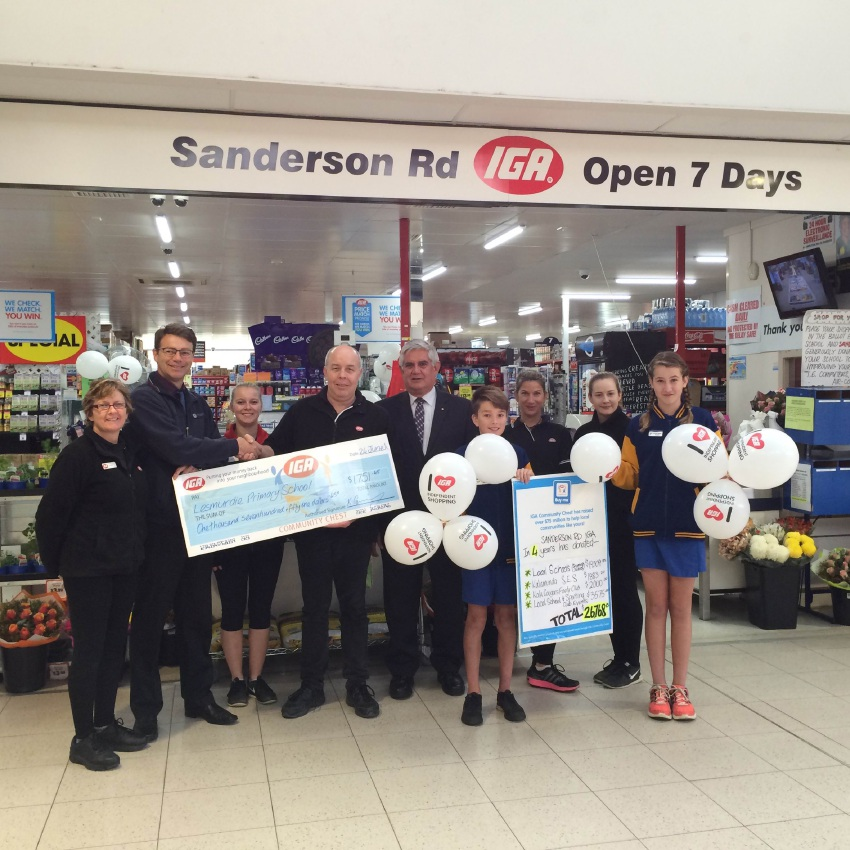 Lesmurdie Primary School principal Kevin Donetta with head students Tren and Darcy accept a cheque from Stephen and Karen Gurney while Ken Wyatt watches and the IGA staff members look on. Picture: Supplied
