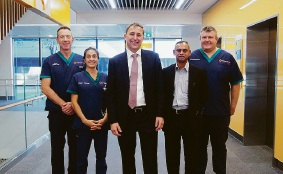 Dr Glen Power (centre) with four hospital heads of department.