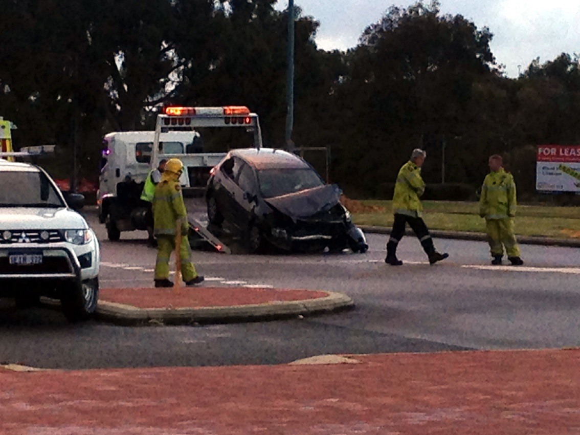 A damaged car is towed from the scene on Joondalup Drive on Monday. Pictures: Mark Donaldson