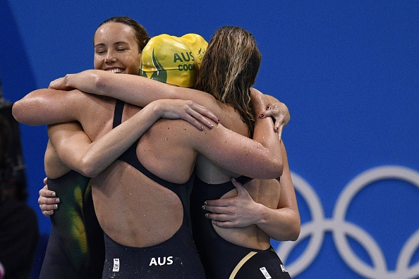 The Australian girls celebrate their silver.