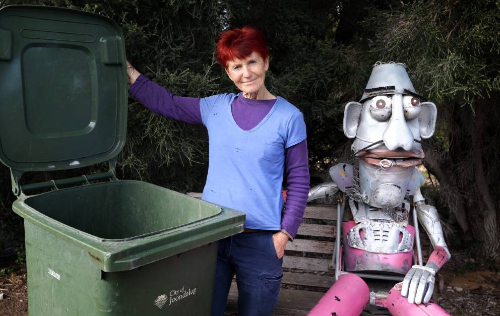 Bin there: Waste education officer Peg Davies with 'Dude on a Bench' by Ken Allen. File picture: Martin Kennealey d457918