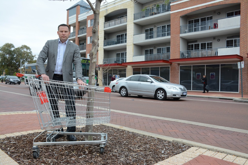 Joondalup MLA Jan Norberger with an abandoned shopping trolley in the Joondalup CBD.