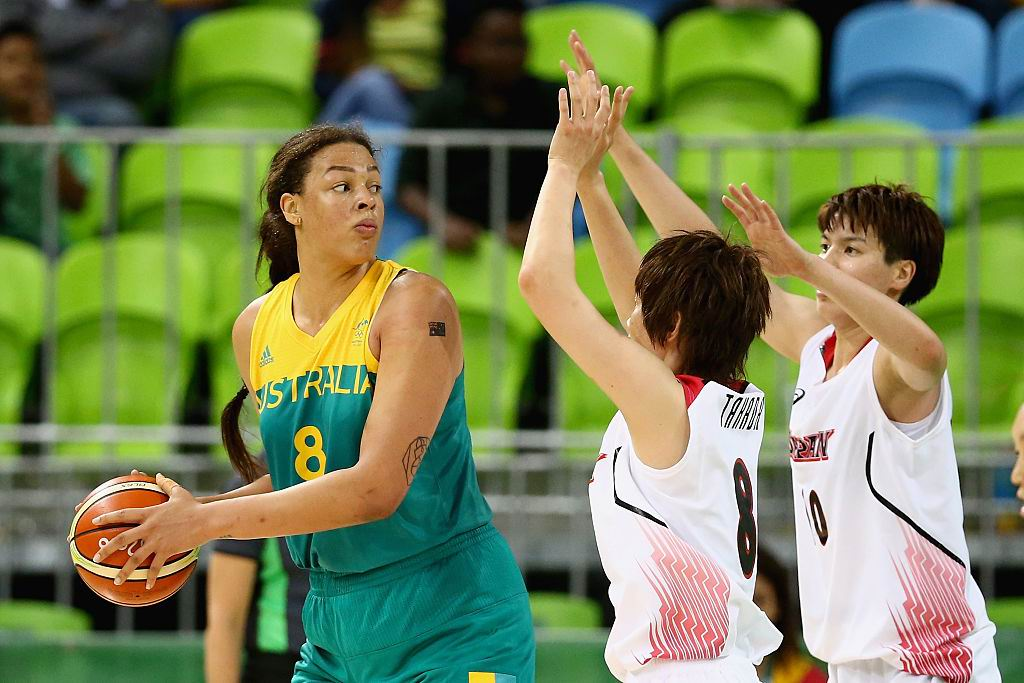 Naho Miyoshi (8) and Ramu Tokashiki (10) defend Liz Cambage (8) during Australia's Preliminary Group B win over Japan. Picture: Sean M. Haffey/Getty Images