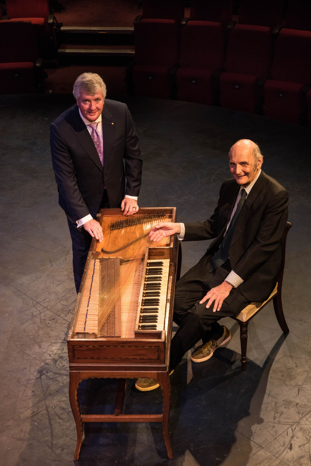 Professor Geoffrey Lancaster (left) and Stewart Symonds with the First Fleet piano he donated to ECU.