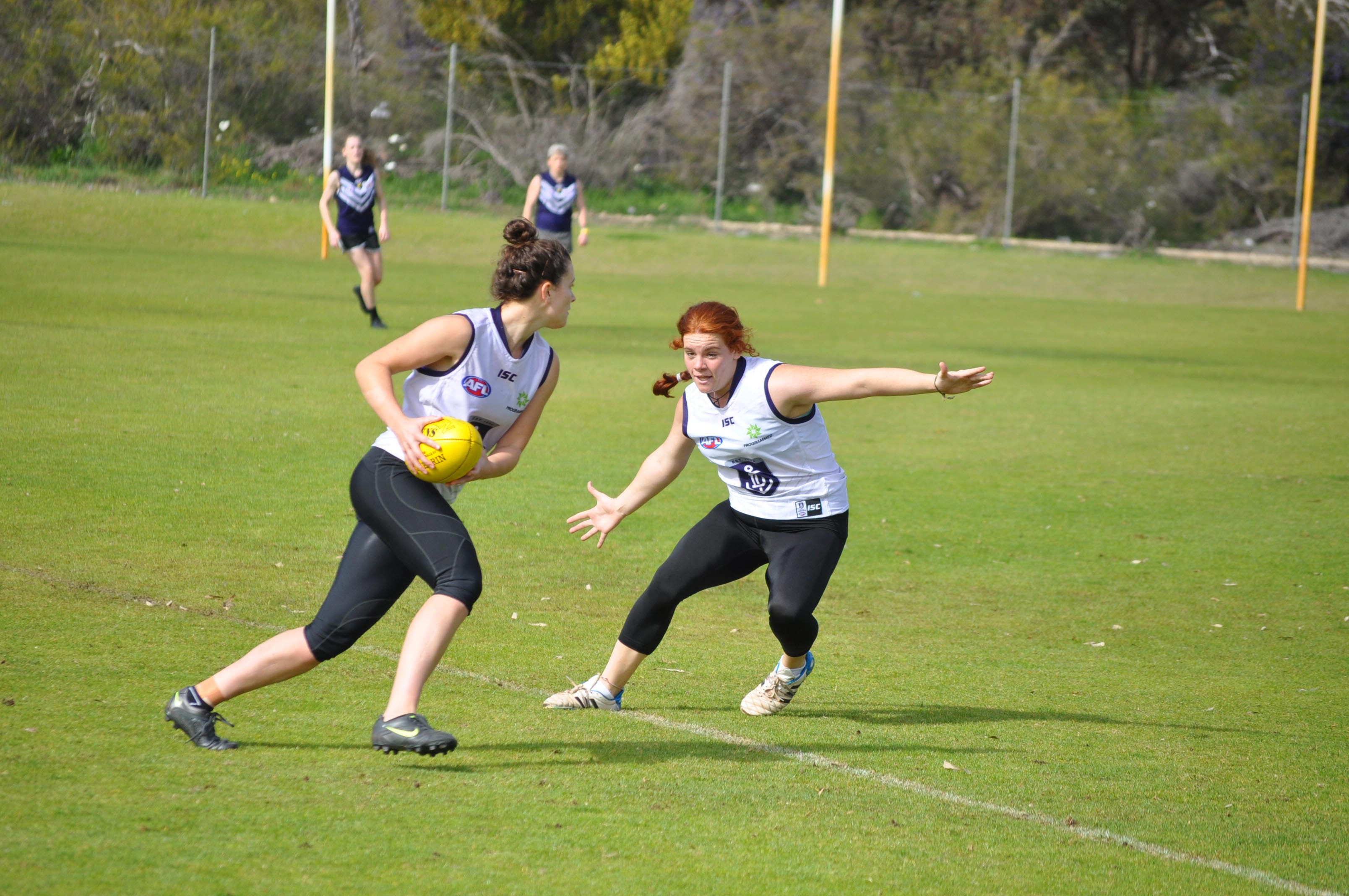 Two potential Fremantle Dockers players show their stuff during the talent search.