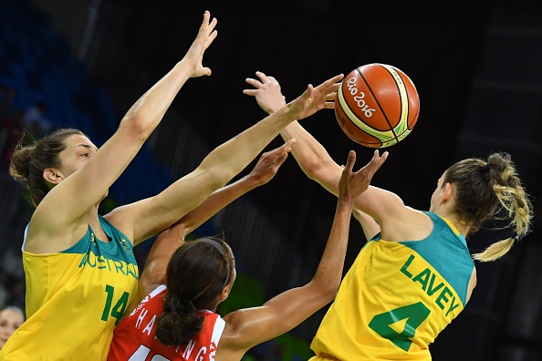 (From L) Australia's centre Marianna Tolo, Belarus' guard Lindsey Harding and Australia's point guard Tessa Lavey battle it out. Photo: Getty