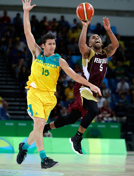 Venezuelan Gregory Vargas shoots as Damian Martin defends during the preliminary round game at the Rio 2016 Olympic Games.  Picture: Jamie Squire/Getty Images.