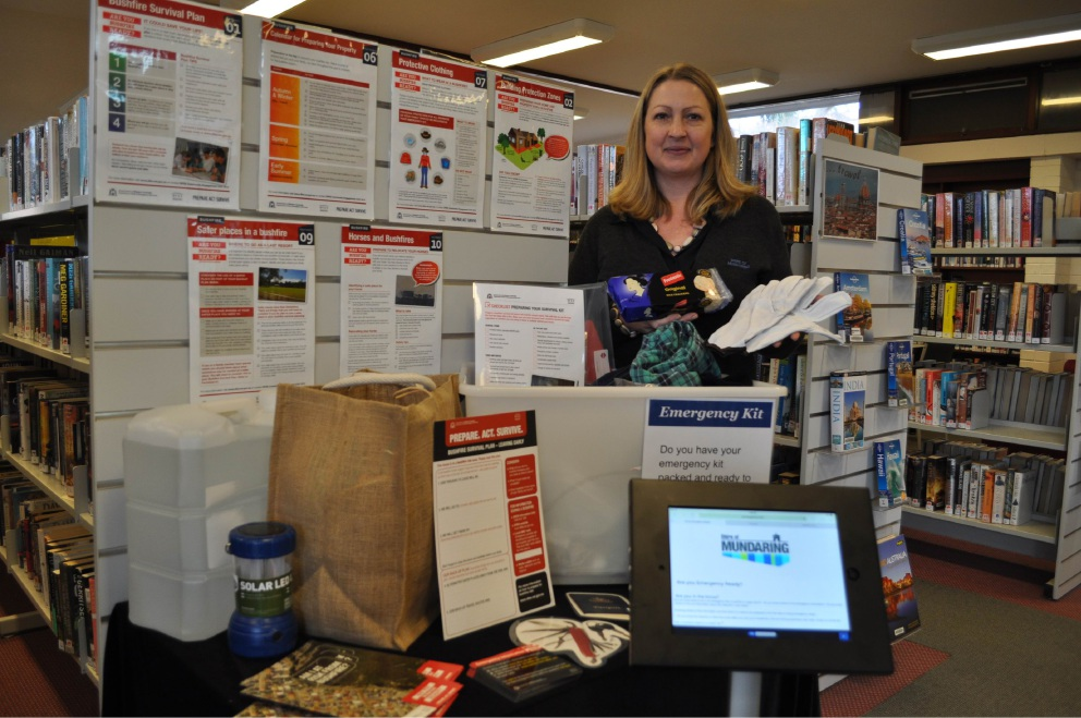 Library officer Bronwyn McNabb with a sample emergency kit.