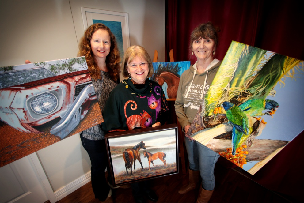 Lynette Maisey, of Baskerville, Gina Wade, of Brigadoon, and Gilly Huber, of The Vines, get ready for the exhibition. Picture: David Baylis d457704