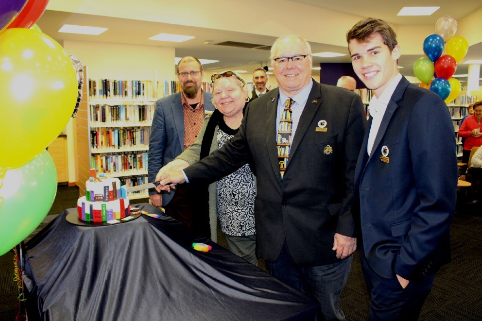 Ballajura Library manager Shane Dowling and councillors Maria Hayes, Dave Lucas and Adam Kovalevs cut the cake.