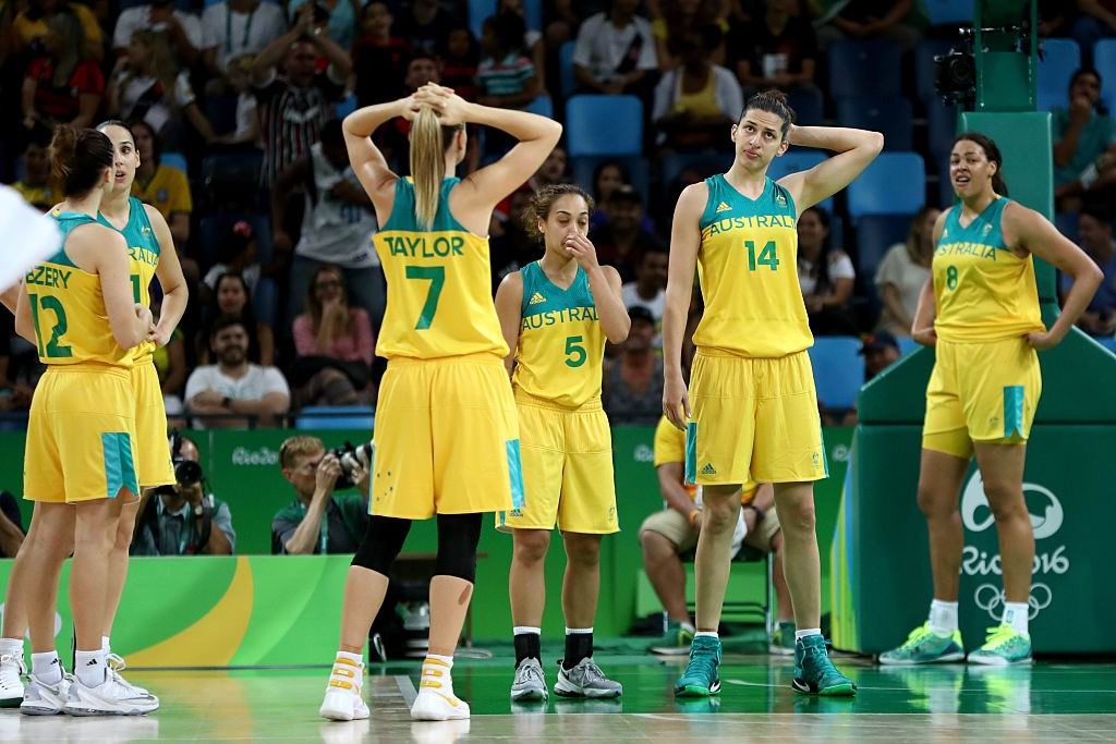 Australia stand dejected following its loss to Serbia. Picture: Phil Walter/Getty Images