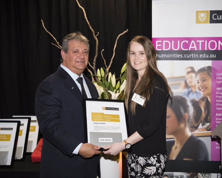 Currambine teacher Renae Jackson receives her award from Armando Giglia from the WA Secondary School Executives Association.