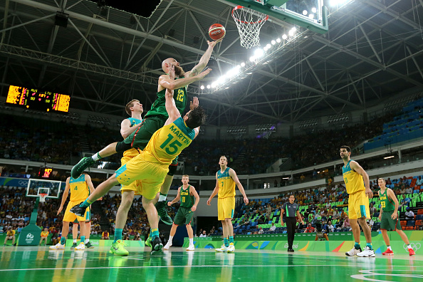 Damian Martin defends against Lithuania's Antanas Kavaliauskas during the men's basketball quarter final at the Rio Olympics. Picture: Mike Ehrmann/Getty Images.