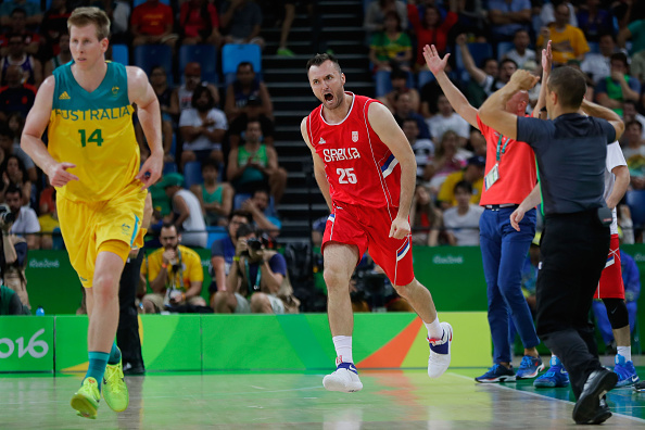 Serbian Milan Macvan reacts after scoring against Australia during the men's basketball semi-final at the Rio Olympics. Picture: Jamie Squire/Getty Images.