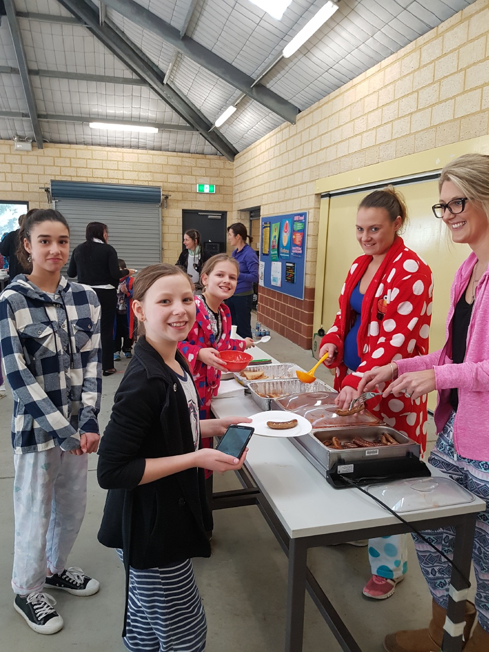 Students Jaslyn Taylor Dunne, Clarissa Stanley and Taloola Blencowe with parent Gemma Wyatt Thompson and teacher Annette Percey at the community breakfast.