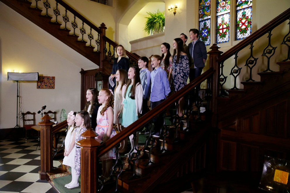 Amy Lehpamer with Perth von Trapp children cast on Government House staircase.