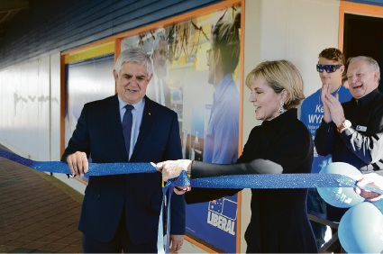 Foreign Minister and Curtin MHR Julie Bishop cuts the ribbon to officially open Hasluck MHR Ken Wyatt's Midland office.