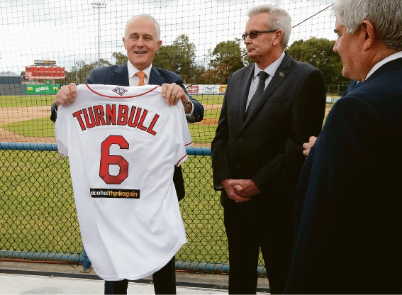 Prime Minister Malcolm Turnbull is presented a Perth Heat team shirt by Baseball WA chairman Stephen Byrne.