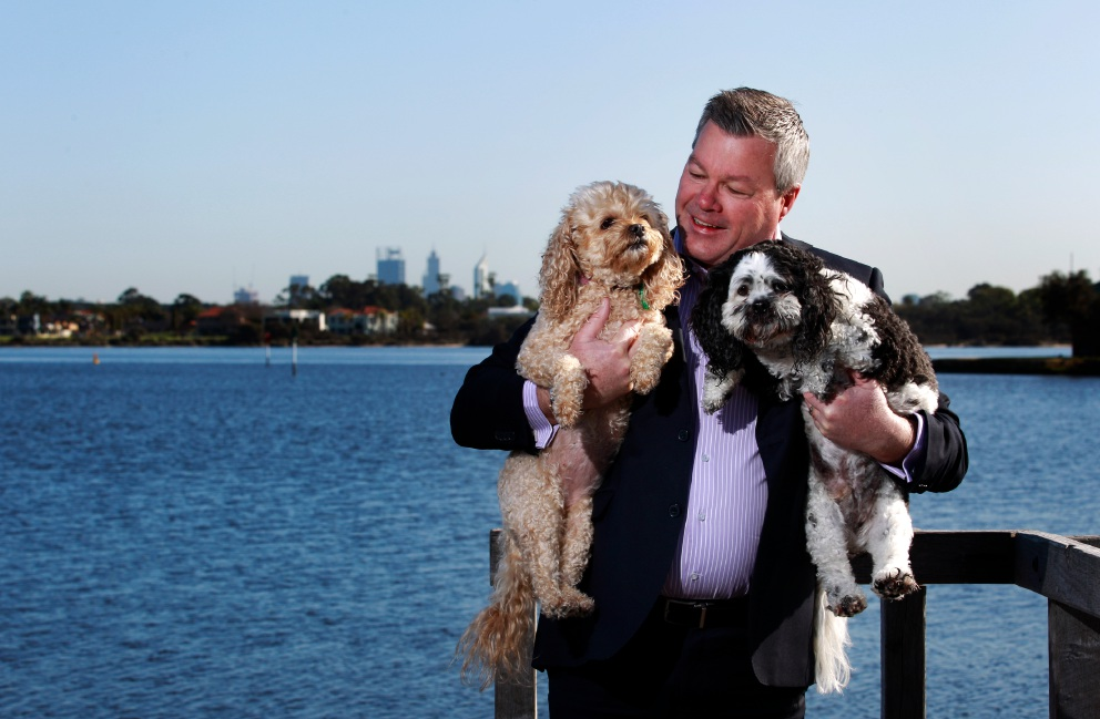 Canning councillor Patrick Hall with his dogs Narla (caramel) and Pokey. Picture: Marie Nirme