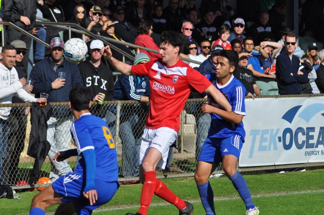 ECU Joondalup midfielder Shane Pickering holds off Cockburn City's Ali Gholami.         Picture: Peter Simcox
