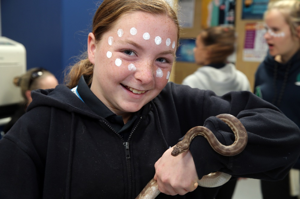 Year 7 student Kayla D''Alton with a Stimpson python.