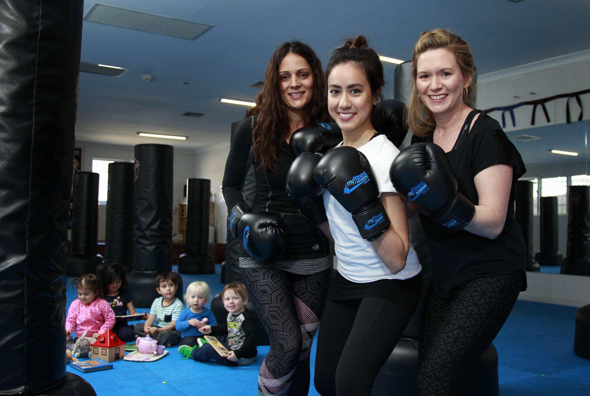 My Fitness Kickboxing instructor Gillian Sarangapany (centre) with Natalie Crockett (left) and Sandra Kirou - the three mothers' children playing in the background (L-R) Zoe Crockett (3), Clara Varley (6), Caleb Varley (4), Alex Kirou (16 months) and John Kirou (3). Picture: Marie Nirme.