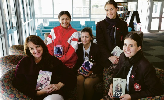 Author Kate McCaffrey with year 11 students Olivia Fernandes,Bianca De Longis,Tess Dorrington and Eva Male. Picture: Martin Kennealey www.communitypix.com.au d455838