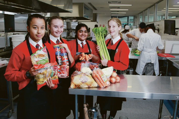 Year 7 students Jayshree Baidya, Lydia Monaghan, Diya Binod, and Lucy Butterfield with some of the ingredients that were used to make 35 litres of minestrone soup for the Salvation Army.