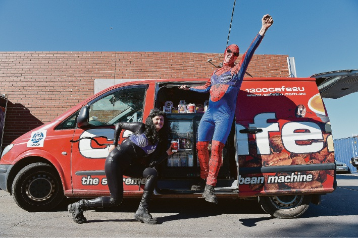 Andy and Mandy Lynch dress up as super heroes as part of the Purple Bra Day cancer awareness campaign.